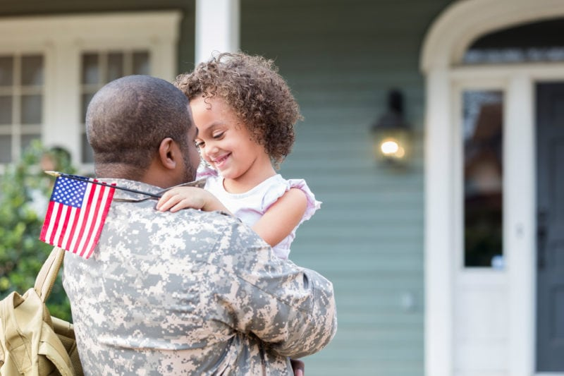 Child with Army father at home